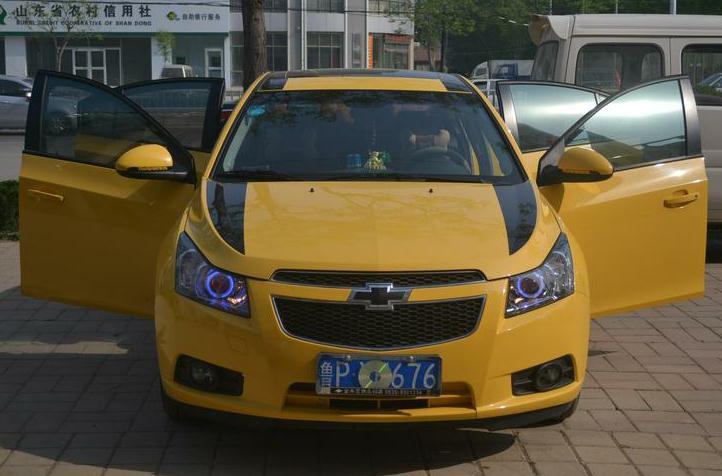 黄色科鲁兹升级透镜 - 大灯改装 - 聊城汽车改灯中心
