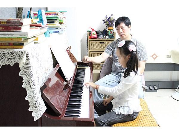 幼儿钢琴教学_渠县艺术学校图片
